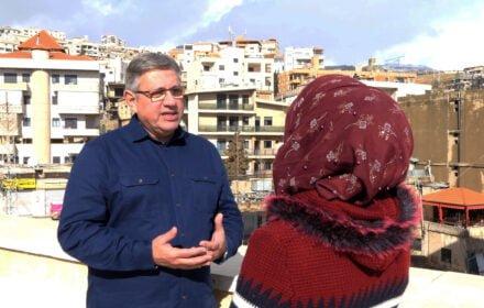Release International Paul Robinson CEO talking to Lebanese woman